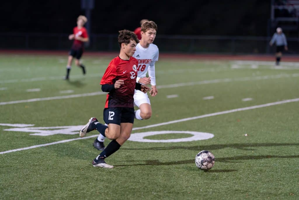 Ty Patterson Advancing the ball.  Charleroi Boys Soccer