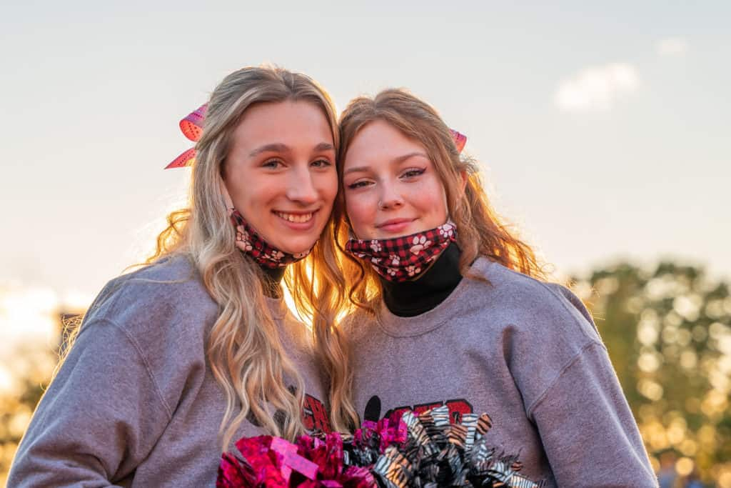 Picture of two cheerleaders.